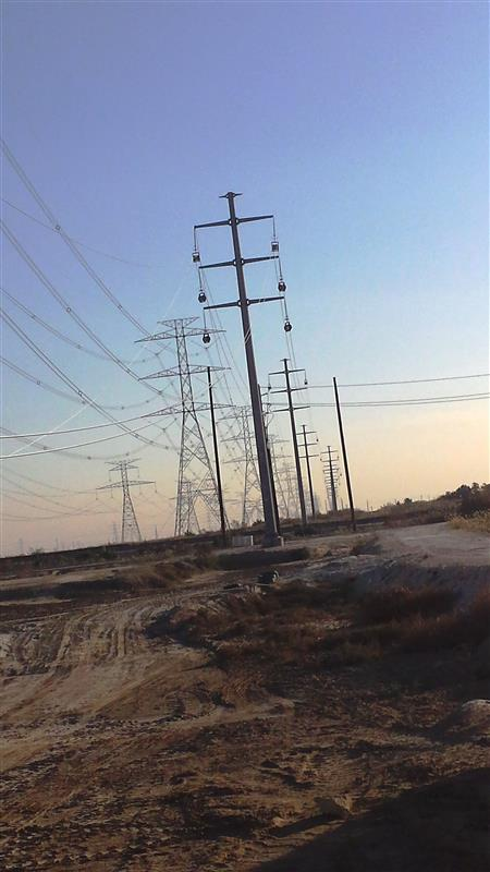115kV Double Circuit Monopole installation and stringing works Two conductor per phase.